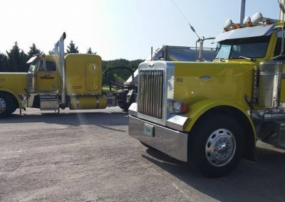 GT 84 Yellow 2007 Peterbilt 379 AKA GT 74 alongside fellow Truck Driver Lennie Wright's Yellow 2003 Peterbilt 379 Truck Driver William Wofford